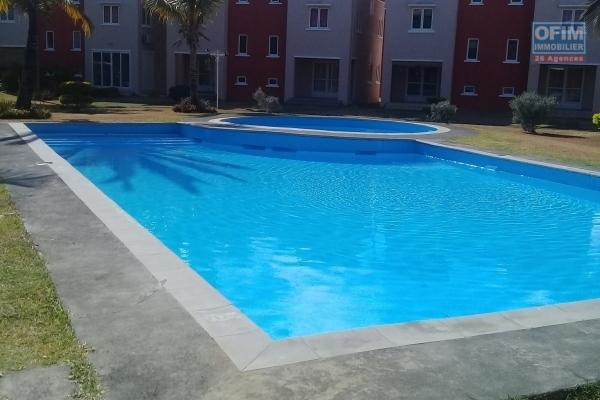 For sale beautiful triplex in a secure residence with pool and close to the beach in Grand Gaube.