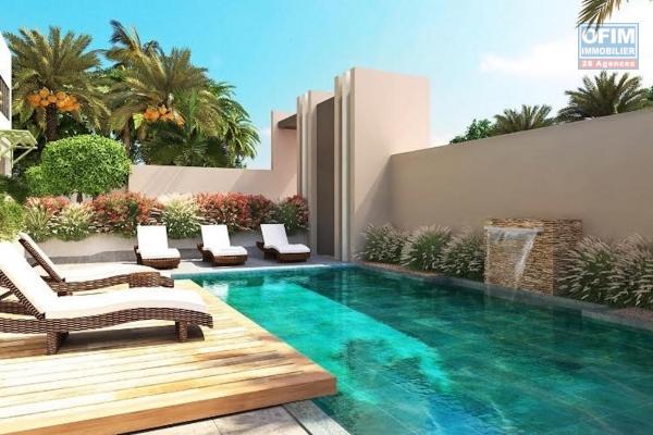 Flic en Flac à vendre appartement 2 chambres avec piscine dans résidence sécurisée 24H/24H, proche de la plage et des commerces au calm.